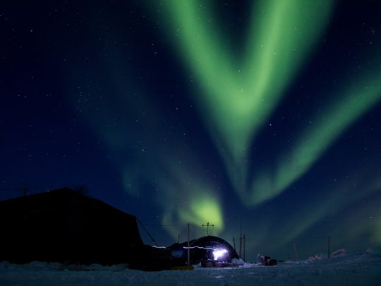 Ice Camp Skate as the aurora borealis displays above camp March 9, 2018 in support of Ice Exercise (ICEX) 2018.