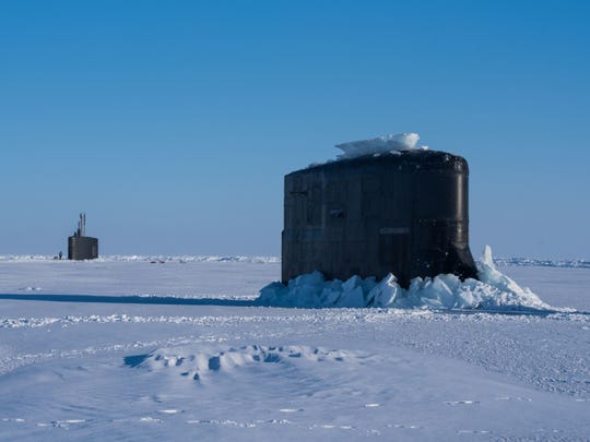 The Navy's Seawolf-class submarine USS Connecticut, seen here punching through Arctic ice in 2018 with another fast-attack submarine, is currently participating in ICEX 2020.
