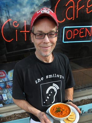 Owner Brad Royal holds a bowl of his tomato-dill soup at the City Cafe, 443 N. Pennsylvania St., Indianapolis, on Friday, January 11, 2013.
