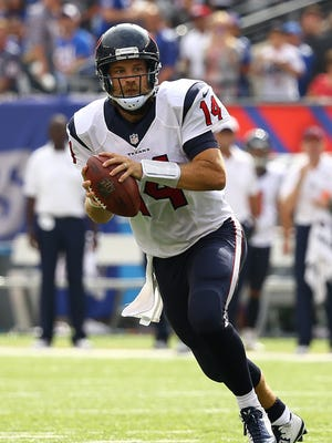 Ryan Fitzpatrick looks to pass against the New York Giants at MetLife Stadium on Sept. 21.