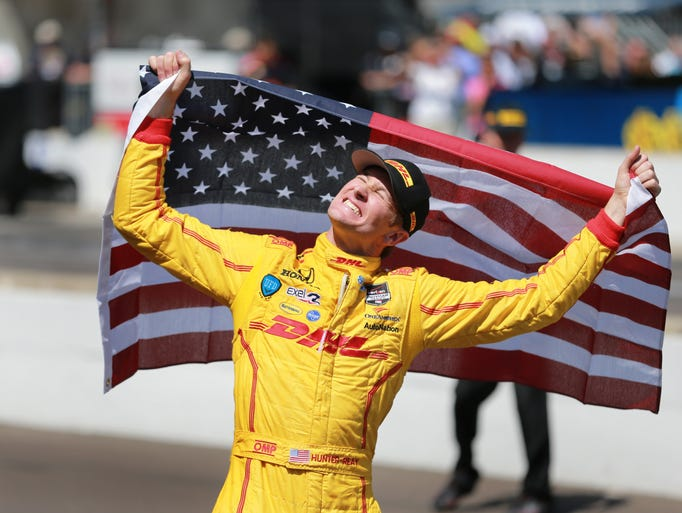 Ryan Hunter-Reay celebrates after he won the 98th running