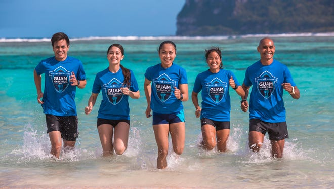 The United Airlines Guam Marathon named Derek Mandell, Rhea Macaluso, Manami Iijima, and Leo Tkel as this year's local event ambassadors. From left: Mandell, United Airlines Guam Marathon spokeswoman Carmela Tyquiengco, Macaluso, Iijima and Tkel.