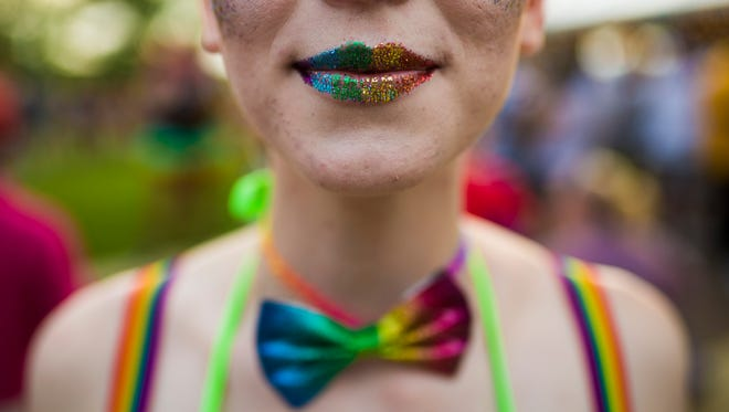 Rainbow lips and bow ties during the Kentuckiana Pride Festival Parade on Main Street. June 16, 2017