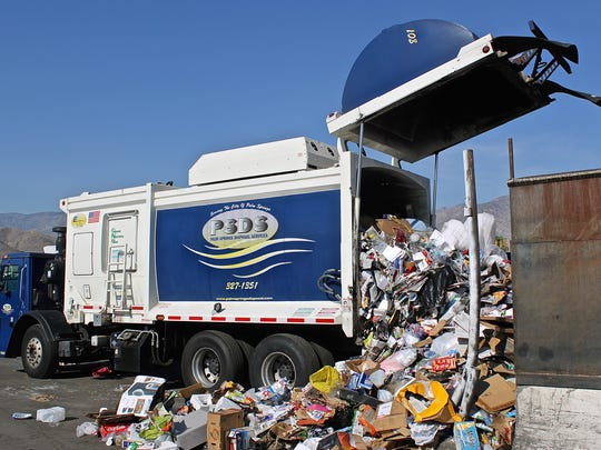 A Palm Springs Disposal Services truck dumps a load of recycling.