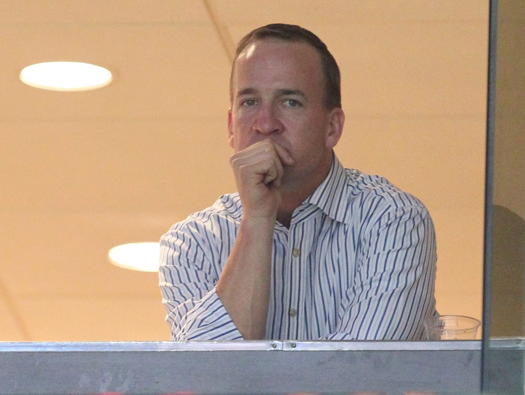 Denver Broncos quarterback Peyton Manning looks on during a game between the Memphis Grizzlies and the Oklahoma City Thunder in Memphis in April.