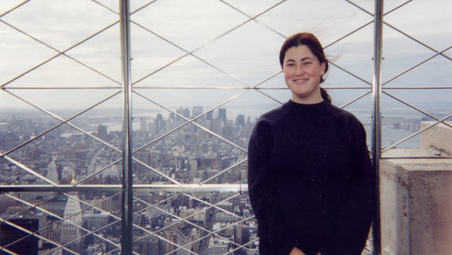 ADVANCE FOR USE SUNDAY, OCT. 26, 2014, AND THEREAFTER- This undated photo provided by Cristina Ribau Orama shows Maria Fernandes on the observation deck of the Empire State Building during a visit to New York not long after she moved to the U.S. from Portugal in late 2001. Fernandes was born in Fall River, Mass., to Portuguese immigrant parents. When Fernandes was 11 her father retired and moved the family to Gafanha da Encarnacao, his hometown of 5,000 on Portugal's Atlantic coast. Fernandes died while napping in her car between one of her three jobs.(AP Photo/Cristina Ribau Orama)