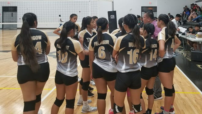 Tiyan High takes a timeout, down 10-16 in the first set against JFK in an IIAAG game on Sept. 5, 2017, at Tiyan High School.