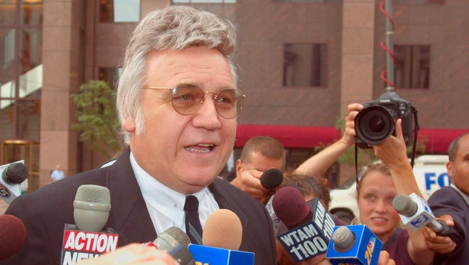 James Traficant Jr. arrives at U.S. District Court in Cleveland to be sentenced for his conviction on bribery and corruption charges on July 30, 2002.