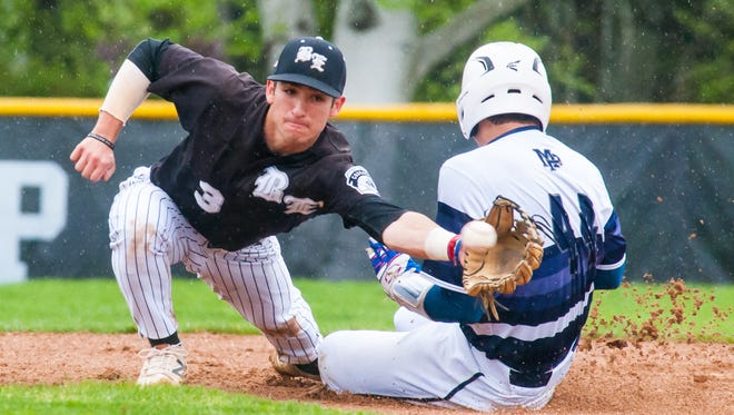 Bishop Eustace shortstop Sky Duff is unable to make the tag as Malvern Prep's Vince Sposato steals second during the title game of the Tom Heinkel Memorial Tournament on Saturday.