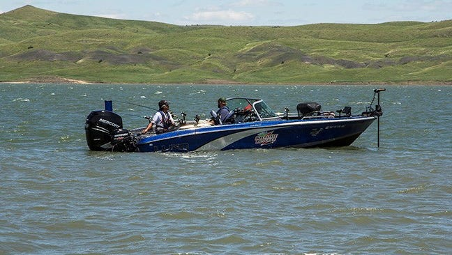 Ted Takasaki uses remote control from the back of the boat while steering the front trolling motor, putting his boat into four wheel drive