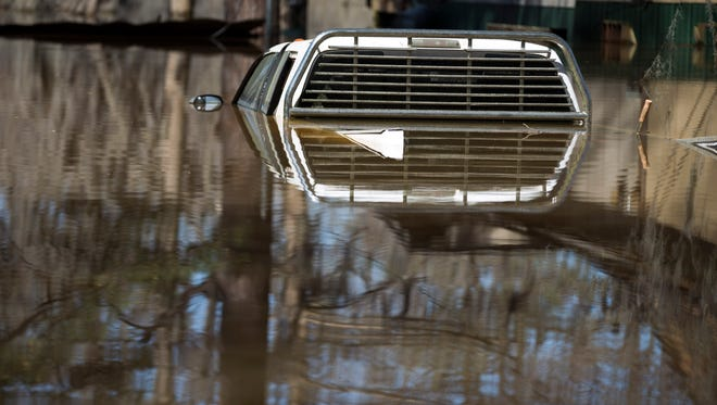 The cab of a truck peers out from floodwater on Butler Camp Road on Lake Bistineau in Sibley March 14, 2016.