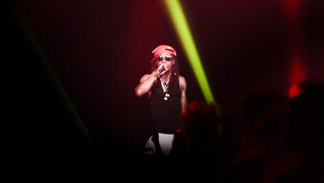 Lil Wayne plays a free concert for UL Lafayette students at the Cajundome April 18, 2016.
