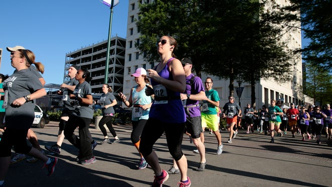 Runners at the start of the Courir du Festival, the Saturday kick-off of Festival International in downtown Lafayette April 23, 2016.