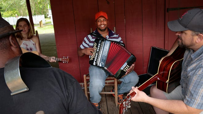 Gerald Delafose, center, leads a creole music jam during  Creole Culture Day at Vermilionville June 12, 2016.
