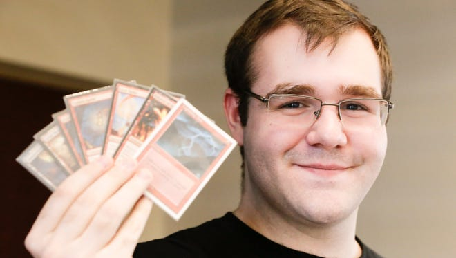 University of Louisiana at Lafayette senior Donald Smith, a 21-year-old math major plays the card game Magic Wednesday, Feb. 15, 2017.