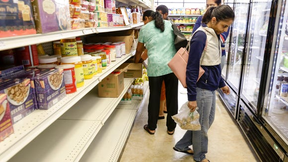 Shoppers at Desi Spice Bazaar in Lafayette Weds., March