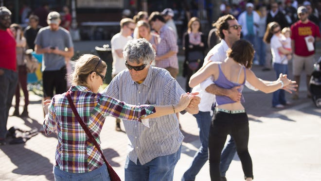 Dancers enjoy Roddie Romero and the Hub City Allstars during the first Acadiana Po-Boy Festival in downtown Lafayette April 2, 2016.