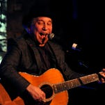 Paul Simon performs during a Phil Everly Benefit Concert at Sylvia Roberts' house in Nashville on Wednesday Oct. 29, 2014.