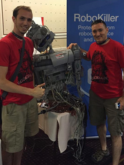 Bryan Moyles, left and Ethen Garr, right, promote RoboKiller at Def Con hacker fest.