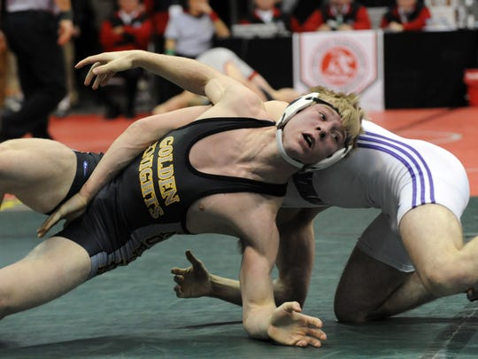 Northmor's Conan Becker wrestles Wooster Triway's Brian
