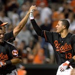 epa04884408 Baltimore Orioles third baseman Manny Machado (L) celebrates with team mates after hitting a 2 run walk off homer against the Oakland Athletics at Camden Yards in Baltimore, Maryland, USA, 14 August 2015. EPA/SHAWN THEW