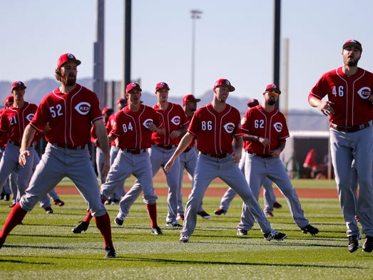 Cincinnati Reds pitchers warm up for practice during