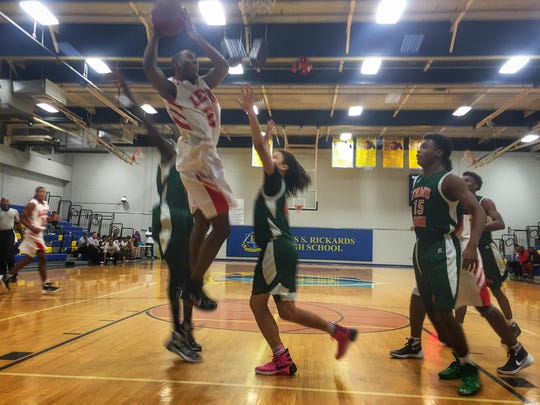 Leon junior Trejan Davis goes up for a layup against FAMU DRS during Monday's MLK Inspire Classic at Rickards. Davis' father Rick is the head coach.