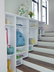 Get all the stuff out of the hall and off the floor neatly into cubbies.