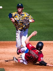 Arizona Diamondbacks catcher Tuffy Gosewisch is forced out at second base by West Virginia University infielder Cole Austin during game at Salt River Fields at Talking Stick, Monday, February 29, 2016.  Austin has since transferred to Arizona State.