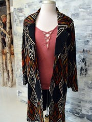 When walking to class on a brisk fall day, throw on a bold patterned jacket like this Aztec one to keep warm.