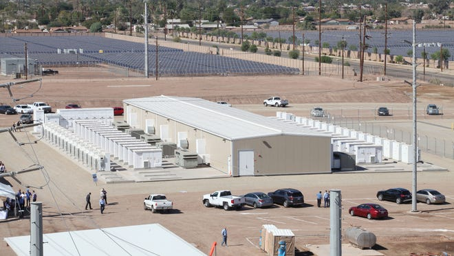 The Imperial Irrigation District's 30-megawatt battery storage facility in El Centro, California. The district also buys power from the 25-megawatt Sol Orchard solar farm, seen here behind the warehouse housing the battery facility.