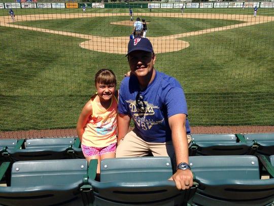James Kramer and his daughter, Maisa, enjoy a game