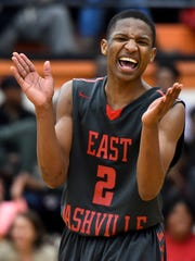 East Nashville's Gene Holmes (2) reacts during the