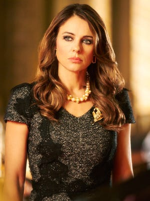 """This photo mades available by E! Television shows Elizabeth Hurley as Queen Helena, the Queen of England in a new TV drama series """"The Royals"""" which is currently filming and being set in London. The show is due for transmission in early 2015. (AP Photo/E! Television, James Dimmock)"""