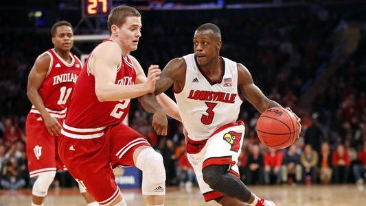 Louisville guard Chris Jones (3) drives around Indiana guard Nick Zeisloft (2) in the first half of an NCAA college basketball game at Madison Square Garden in New York, Tuesday, Dec. 9, 2014.