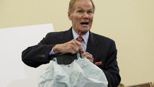 Sen. Bill Nelson, D-Fla., shows a bad air bag at a hearing in November.