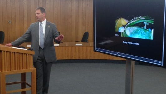 Eaton County Prosecutor Douglas Lloyd shows officer body camera video in Deven Guilford's shooting death.