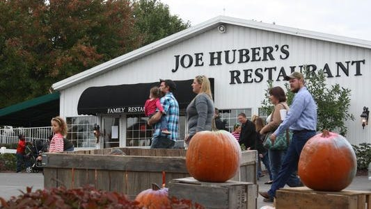 Thousands flock to Joe Huber's Family Farm and Restaurant in Starlight. A mower accident July 27 claimed the life of Joe Huber III, the oldest son of the company's founder.