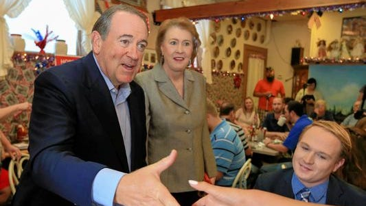 Janet Huckabee (center) joins her husband, GOP presidential candidate Mike Huckabee (left) on the campaign trail in Iowa. Janet Huckabee will speak in a public forum at 11 a.m. Wednesday at Louisiana College.