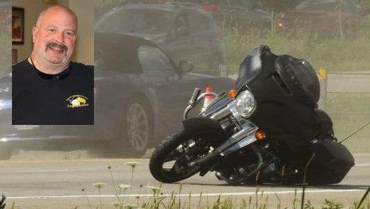 A touring style motorcycle lies tipped facing the wrong direction in the northbound lanes of U.S. 23. Its rider, Gaines resident Delbert Loomis, inset, crashed when he tried to avoid a car making an illegal U-turn south of the Clyde Road exit.