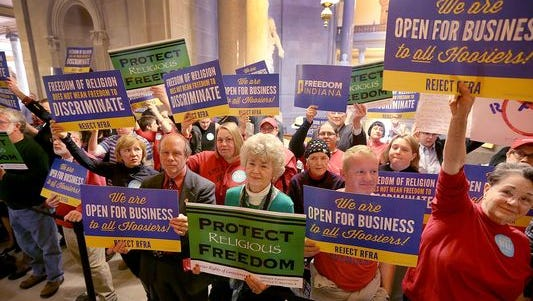 Supporters and opponents of the Religious Freedom Restoration Act, or RFRA, made their opinions known at the Indiana Statehouse on March 19, 2015.