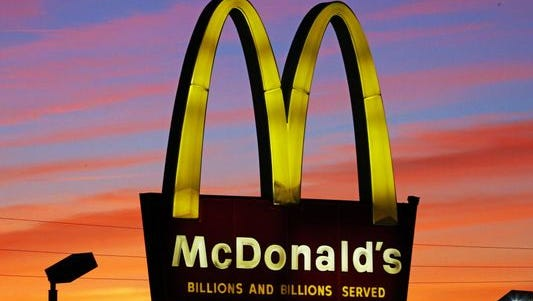 """In this Oct. 10, 2015, photo, the sun sets behind a McDonald's in Ebensburg, Pa. McDonald's hopes it has a catchy, new deal that will be as hugely popular as its Dollar Menu. Starting Jan. 4, 2016, the fast-food chain will launch the """"McPick 2"""" menu, which will let customers pick two of the following items for $2: a McDouble, a McChicken, small fries and mozzarella sticks."""