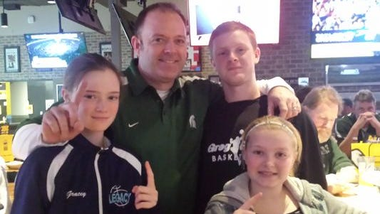 Livingston County football fans love watching their favorite college football teams at the Buffalo Wild Wings in Howell. Jim Metz and his kids watched the MSU-U-M game there last year.
