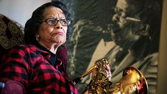 Vivian Branch, widow of musician Ben Branch, holds his saxophone. Dr. Martin Luther King Jr. was talking to Branch when he was shot in 1968 at the Lorraine Motel.