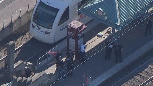 Police respond to a stabbing at the Hollywood Transit Center in Portland, Ore.