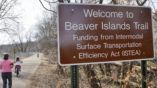 A steady stream of walkers and bikers populate Beaver Islands Trail.