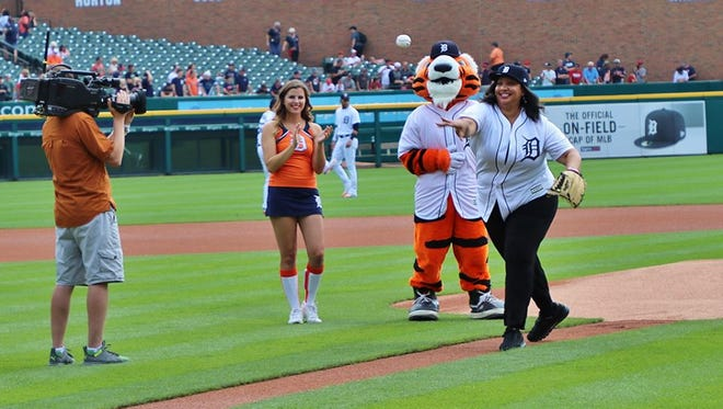 NABJ President Sarah Glover throws the first pitch at Sunday's Detroit Tigers-Cleveland Indians game at Comerica Park. One of the goals of the NABJ is connecting with the city of Detroit and its residents.