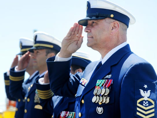 Senior Chief Boatswain's Mate Kevin Wyman salutes during
