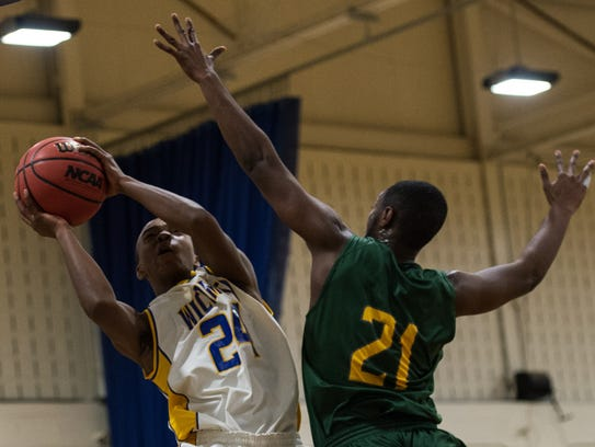 A Mardela player goes up for block against a Wi-Hi player.