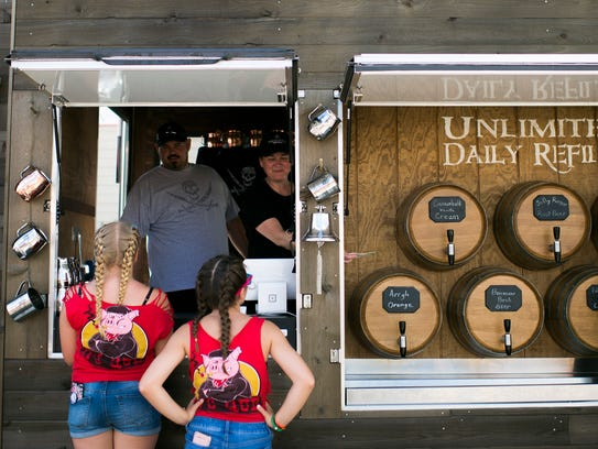 Young BBQ festival goers wait in line to order soda